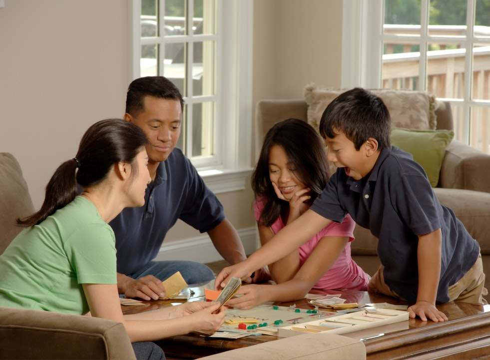 A family playing game in the living rooms
