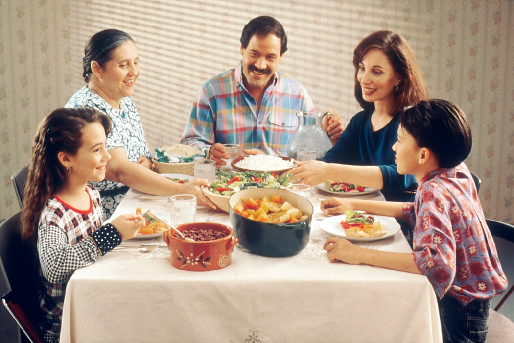 A family eating on a dining table